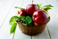 Ripe apples with leaves in the basket on wooden table - PhotoDune Item for Sale