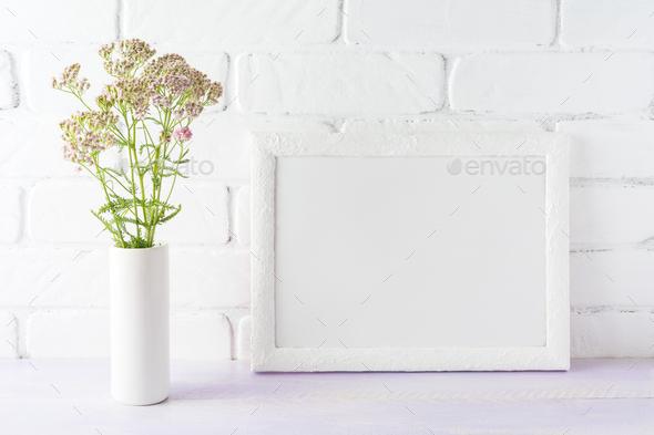 White landscape frame mockup creamy pink flowers in cylinder vas - Stock Photo - Images