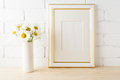 Gold decorated frame mockup with daisy near painted brick wall - PhotoDune Item for Sale