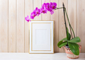Gold decorated frame mockup with purple orchid in wicker basket - PhotoDune Item for Sale