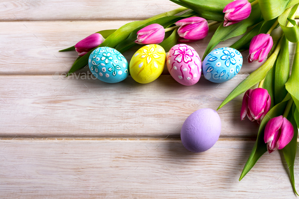 Easter hand painted floral decorated eggs with pink tulip - Stock Photo - Images