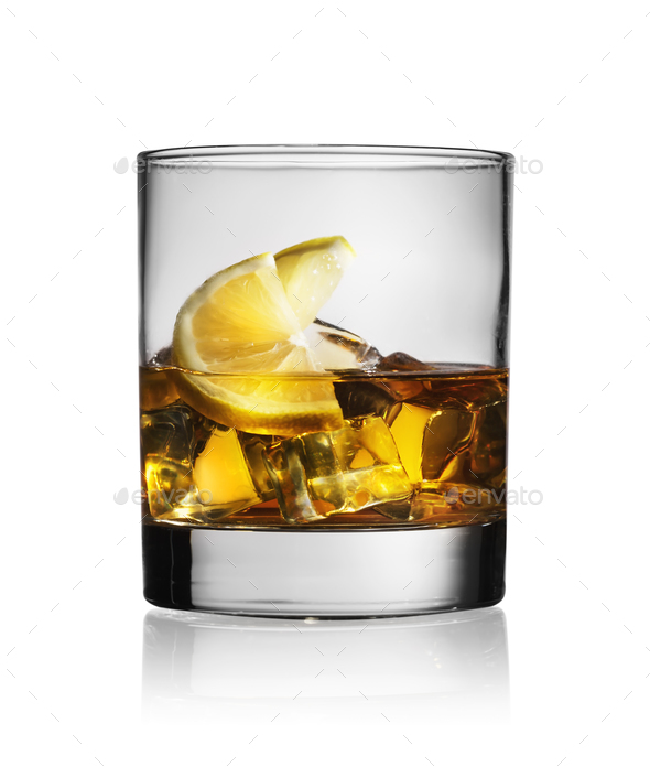 Cocktail with whiskey lemon and ice - Stock Photo - Images