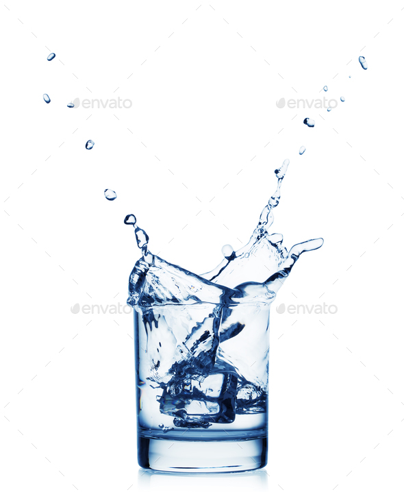 Splash of water in a wide glass with ice - Stock Photo - Images