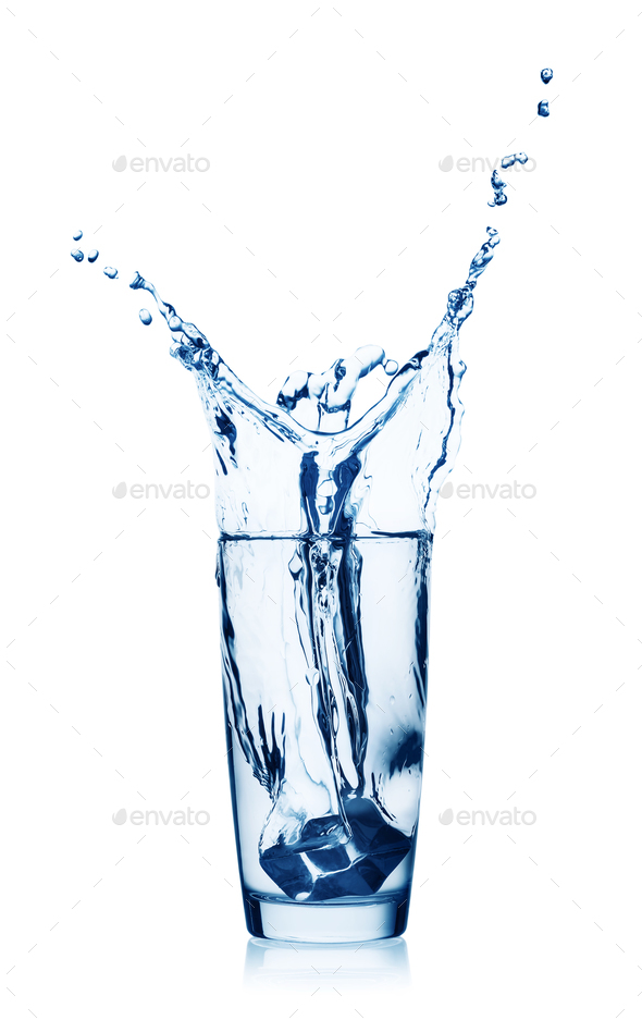 Splash of water in a glass with ice - Stock Photo - Images