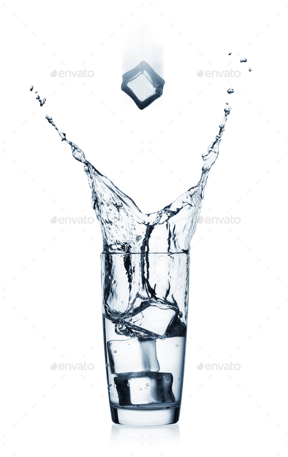 Splash in glass with clear water and flying ice cube - Stock Photo - Images