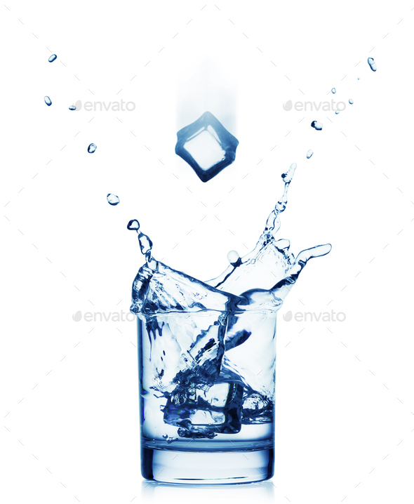 Splash of water in a wide glass with a flying ice - Stock Photo - Images