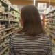 Woman Walking Along Shelves with Products - VideoHive Item for Sale