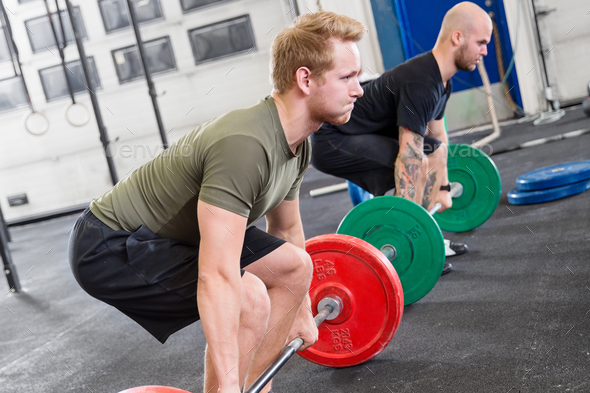 Two dedicated men trains deadlift at fitness gym center - Stock Photo - Images