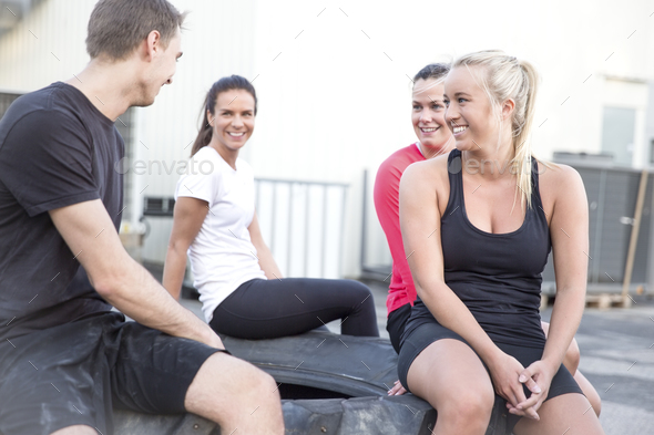 Happy workout team taking a break outdoor - Stock Photo - Images
