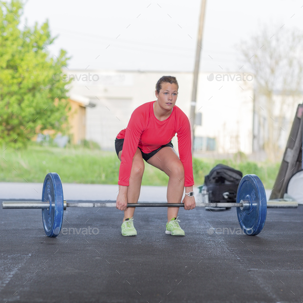 Fitness woman trains deadlift at the gym - Stock Photo - Images