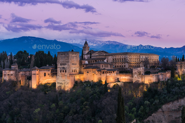 Illuminated Arabic Alhambra palace in Granada,Spain - Stock Photo - Images