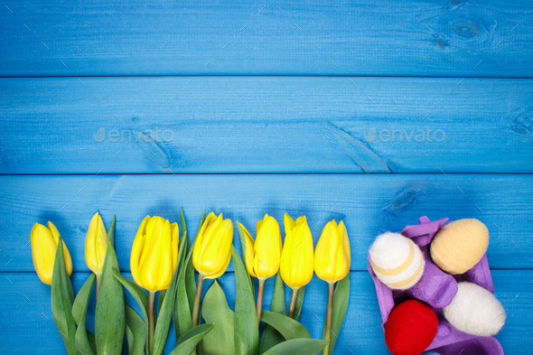 Bouquet of fresh tulips and Easter eggs wrapped woolen string - Stock Photo - Images