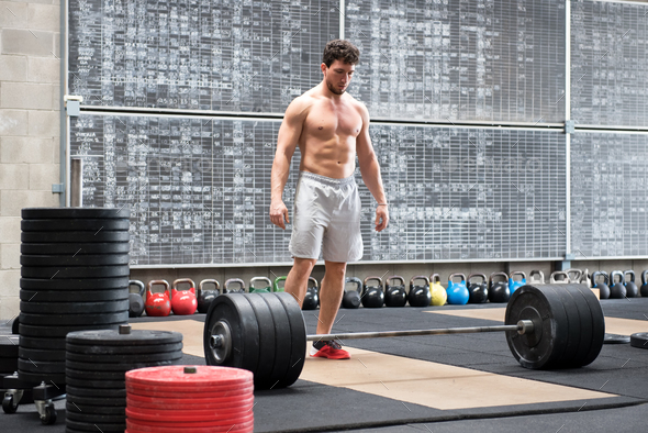 Athlete psyching himself up before lifting weights - Stock Photo - Images
