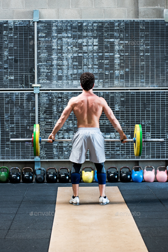 Fit muscular athlete viewed from the rear - Stock Photo - Images