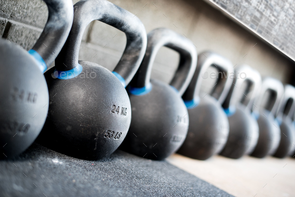 Row of kettlebell or girya weights in a gym - Stock Photo - Images