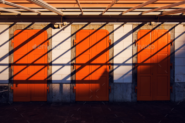 Architecture abstract background, three orange doors and shadows - Stock Photo - Images