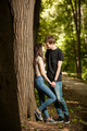 Young couple taking a walk in the forest