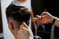 Man in the salon getting a haircut