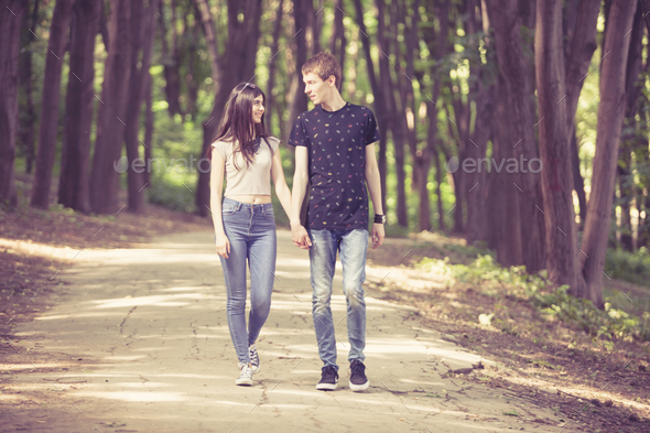 Inlove couple taking a walk in the forest - Stock Photo - Images
