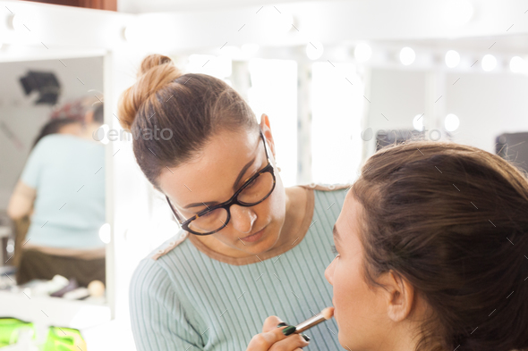 Makeup artist at work in the studio - Stock Photo - Images