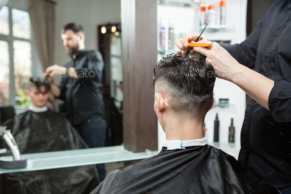 Man in the salon getting a haircut - Stock Photo - Images
