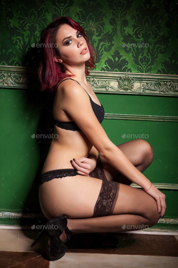 Sensual redhead in lingerie and stockings in vintage interior - Stock Photo - Images