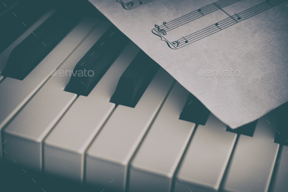 Piano and sheet music paper - Stock Photo - Images