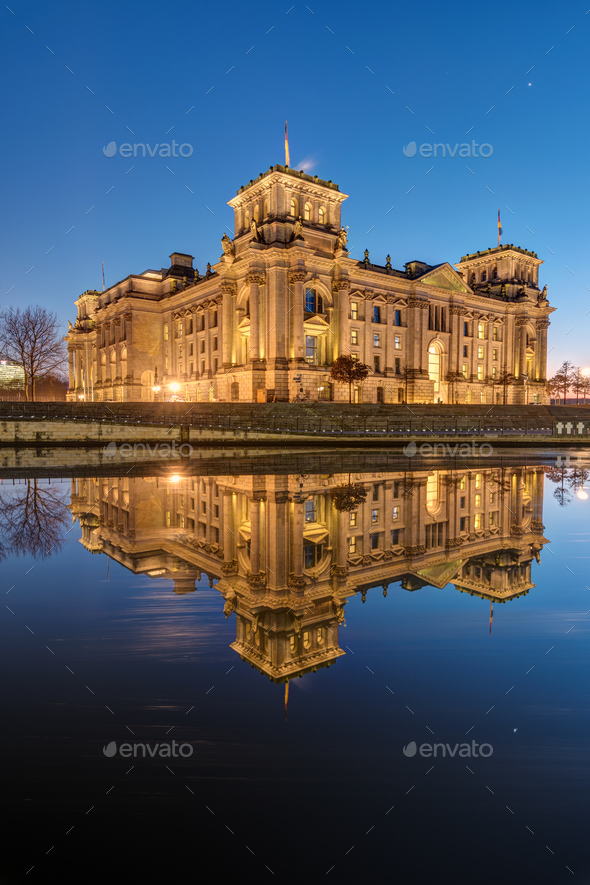 The Reichstag reflects in the river Spree - Stock Photo - Images