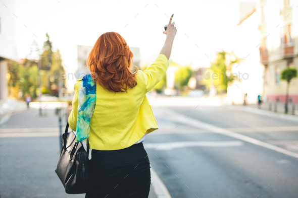 Businesswoman Hailing Taxi - Stock Photo - Images