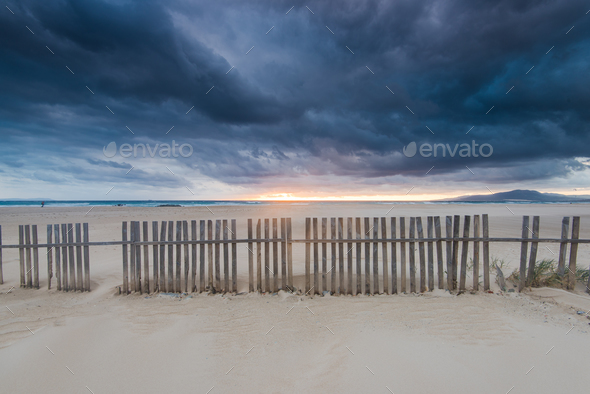 Cloudscape over beach and ocean in Spain, before storm - Stock Photo - Images