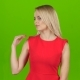 Lady in Red on Green Screen Background Shows Her Hand