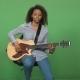 Singing Woman Playing Guitar