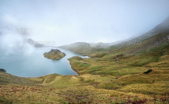 foggy morning on alpine lake - Stock Photo - Images