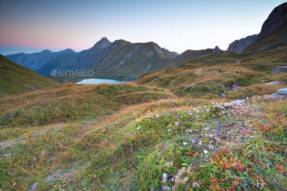 morning over alpine lake - Stock Photo - Images