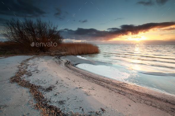 beautiful sunset on Ijsselmeer beach - Stock Photo - Images