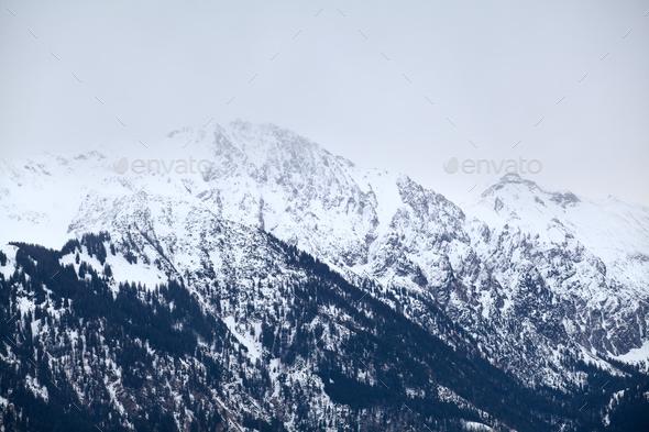 alpine peaks in winter - Stock Photo - Images