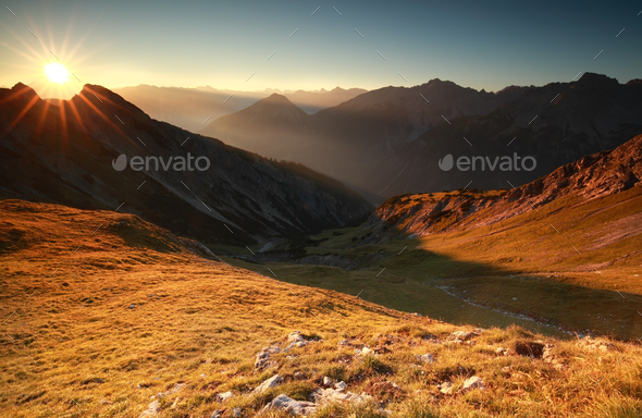 beautiful sunrise in high Alps - Stock Photo - Images