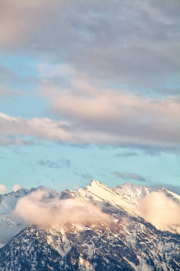 mountain peaks in evening sunlight - Stock Photo - Images