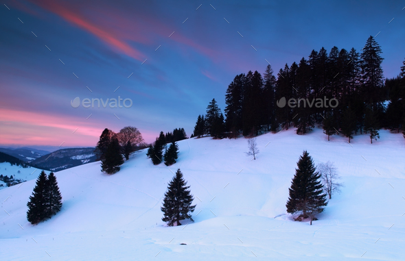 dramatic sunrise over snowy mountains - Stock Photo - Images