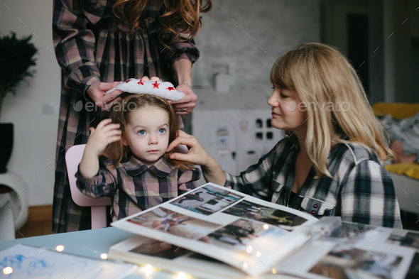 mother, grandmother, the little girl in the room - Stock Photo - Images