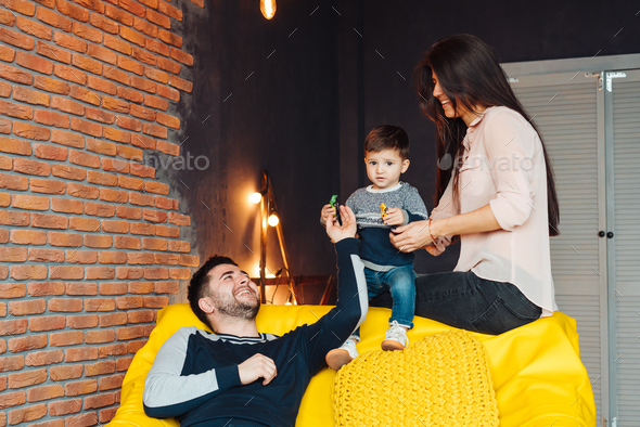 Young family having fun - Stock Photo - Images