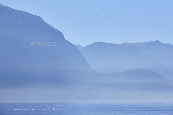 Norwegian fjord landscape at dawn in blue tone. Norway highlight. Horizontal - Stock Photo - Images