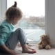 Sad Girl Sitting on Windowsill - VideoHive Item for Sale