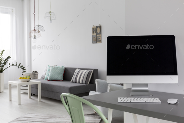 Grey Desk With Computer In Modern Living Room Stock Photo By Bialasiewicz
