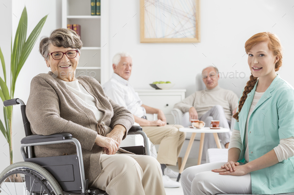 Senior on a wheelchair - Stock Photo - Images