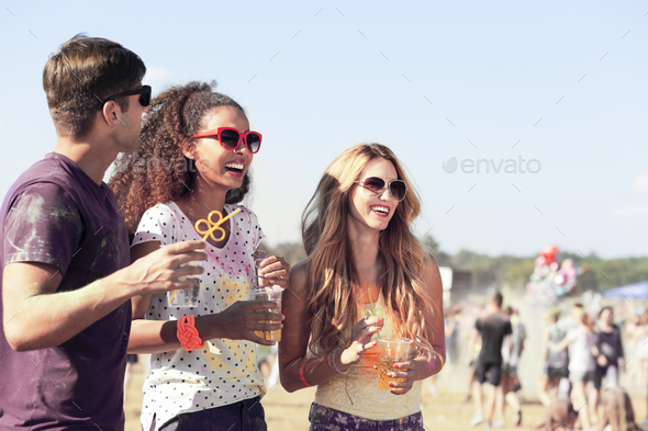 Friends during festival in the fresh air - Stock Photo - Images