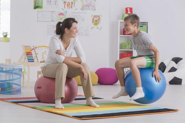 Boy sitting on gym ball - Stock Photo - Images