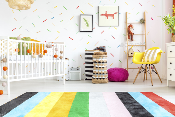 Newborn bedroom with yellow chair - Stock Photo - Images