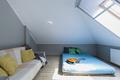 Attic minimalist bedroom with mattress