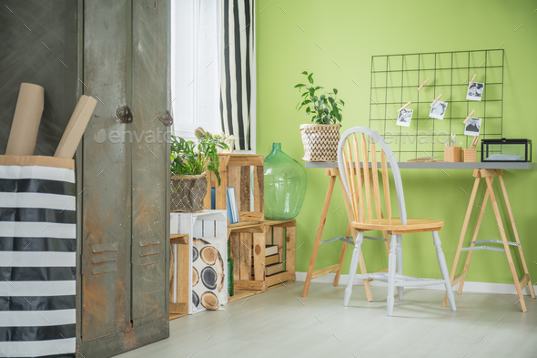 Creative green room with desk - Stock Photo - Images